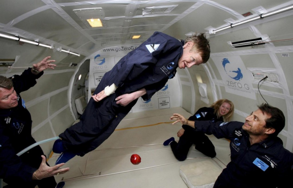 "In this handout photo provided by Zero Gravity Corp., astrophysicist Stephen Hawking floats on a zero-gravity jet, Thursday, April 26, 2007. The modified jet carrying Hawking, a handful of his physicians and nurses, and dozens of others first flew up to 24,000 feet over the Atlantic Ocean off Florida. Nurses lifted Hawking and carried him to the front of the jet, where they placed him on his back atop a special foam pillow. The plane made a total of eight parabolic dips, including two during which Hawking made two weightless flips like ""a gold-medal gymnast,"" said Peter Diamandis, chairman of Zero Gravity Corp., the company that owns the jet. (AP Photo/Zero Gravity Corp.) ** NO SALES ** MANDATORY CREDIT **"